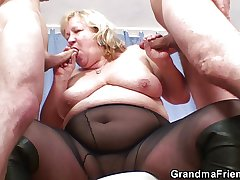 Successful titted grandma swallows two cocks