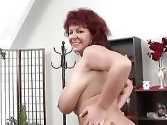 Sexy mature redhead shows her huge tits and arse