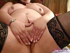 Adult BBW fucks her fat pussy with kickshaw