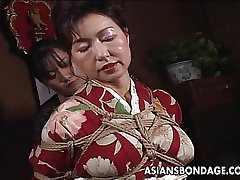 Asian matured bitch has a rope stint to endure
