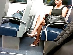 Mature Ebony Lady Crestfallen Legs & High Heels