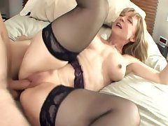 Chubby boobed blonde milf in stockings and a colours
