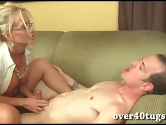 Busty blonde milf gives a sopping handjob