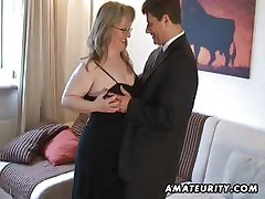 Well-endowed amateur Milf sucks and fucks with cum in excess of tits