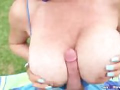 Huge-titted lady POV hanjob