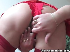 Mature mom less kinky outfit rubs her clit and toys her pussy