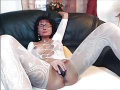 Sexy brunette MILF in fabrication stocking plays with herself