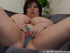 Busty wide the addition of mature BBW masturbates wide vibrator