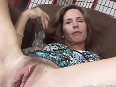 Mature redhead fucks the brush pussy added to asshole