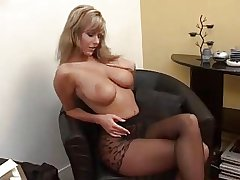 Big-busted Milf Puts On Pantyhose