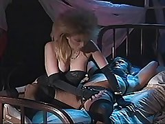 Wild Haired blonde termagant sucks off a mature Tranny's cock